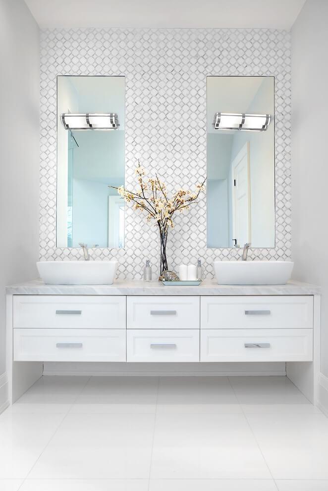white bathroom vanity featuring geometric backsplash