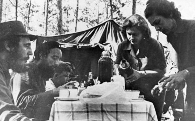 Fidel Castro in Sierra Maestra with Antonio Nu–ez Jimenez and Celia Sanchez Manduley (right) during the War of Liberation. (Photo by: Sovfoto/UIG via Getty Images)