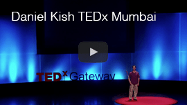 YouTube video thumbnail shows Daniel Kish onstage at the 2013 TEDx Gateway talk in Mumbai, India. Click the thumbnail to go to the video on YouTube.