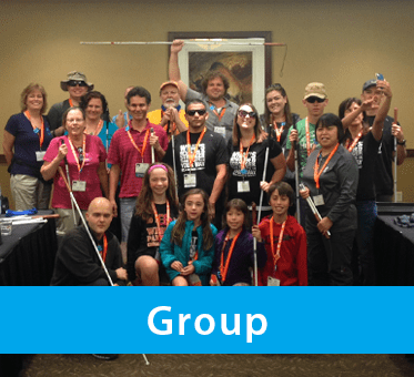 Photo for the Group drop-down banner shows World Access For The Blind's Perceptual Navigation Instructors standing with group workshop participants at the 2015 No Barriers conference.