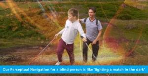 A hybrid photo shows World Access For The Blind Founder and President Daniel Kish walking up a hill in Scotland behind WAFTB student Ethan Loch. Both are holding full-length navigation canes, while Ethan also holds a hiking pole. Superimposed is a photo of of a match head string and shooting sparks. The banner text reads: Our Perceptual Navigation for a blind person is like 'striking a match in the dark'.