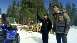 Video thumbnail screengrab shows L Steele-Louchart pointing at object he was identifying with FlashSonar™ echolocation as he stands next to the program host in Rocky Mountain National Park in Colorado.