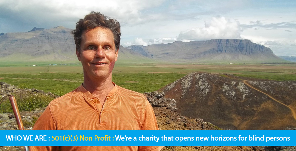 Page Banner shows a photo of Daniel Kish hiking ion a glacial lake bed in Iceland with a mountain range on the horizon. Text band reads: Who We Are: 501c3 Non Profit:We're a charity that opens new horizons for blind persons.