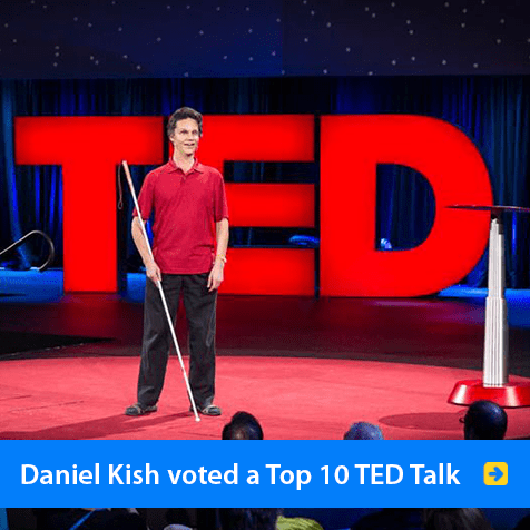 Daniel Kish was voted a Top 10 Talk at TED 2015 in Vancouver. Image shows Daniel onstage with the red TED logo behind him. Click to watch his video at the TED website.