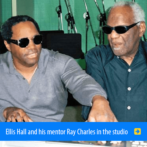 Ellis Hall and his mentor Ray Charles sitting at a digital piano in a recording studio.