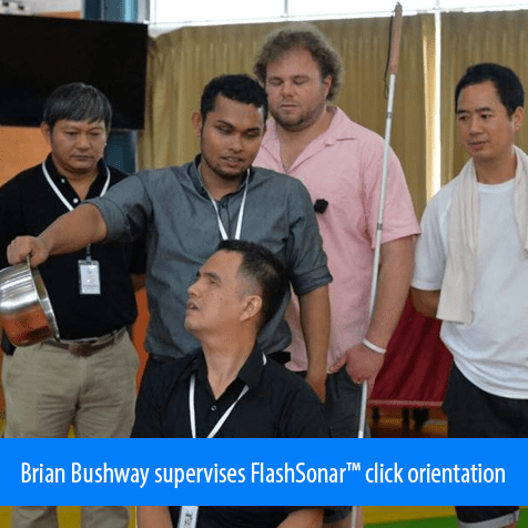 Brian Bushway supervises FlashSonar click orientation. Image: Coach trainee holds a pot to the right of another coach trainee as he clicks to find its location.