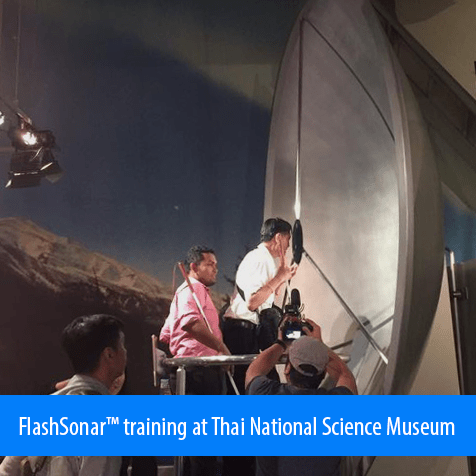 Flash sonar training at Thai National Science Museum. Image: Students are trying their clicks at the center of a parabolic satellite receiver dish.