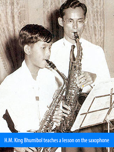 Image: H.M. King Bhumibol teaches a lesson on the saxophone.