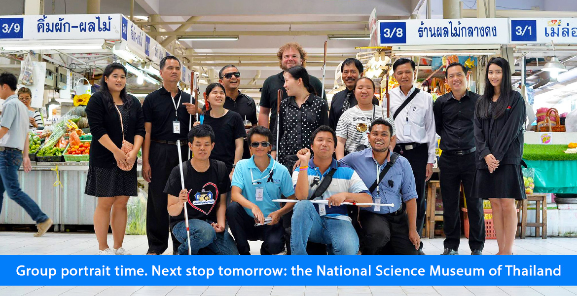 Group portrait time. Next stop tomorrow: the National Science Museum of Thailand. Image shows Juan and brian standing with the students and volunteers in the public market.