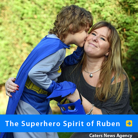 The superhero spirit of Ruben. Photo image shows 9 year-ol Ruben Graham-Morris of Birmingham, England held aloft in the arms of his mother Trudie. Ruben is dressed in a kids' Batman costume.