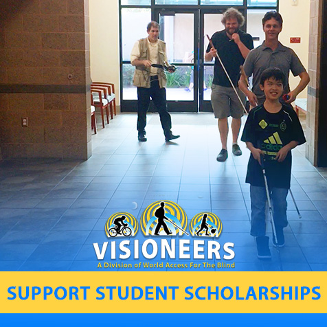 Visioneers. Support Student Scholarships. Image: Junior Visioneer Nathan leads Visioneers Daniel Kish and Brian Bushway down a corridor in a community recreation center by using FlashSonar by way of a hand clicker and his perception cane.