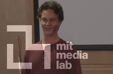 Photo of Daniel Kish with MIT Media lab logo superimposed.