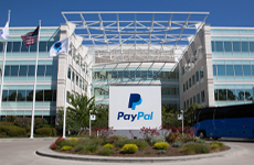 Image: Photograph of the exterior of PayPal's Headquarters showing two building wings joined at a central atrium.