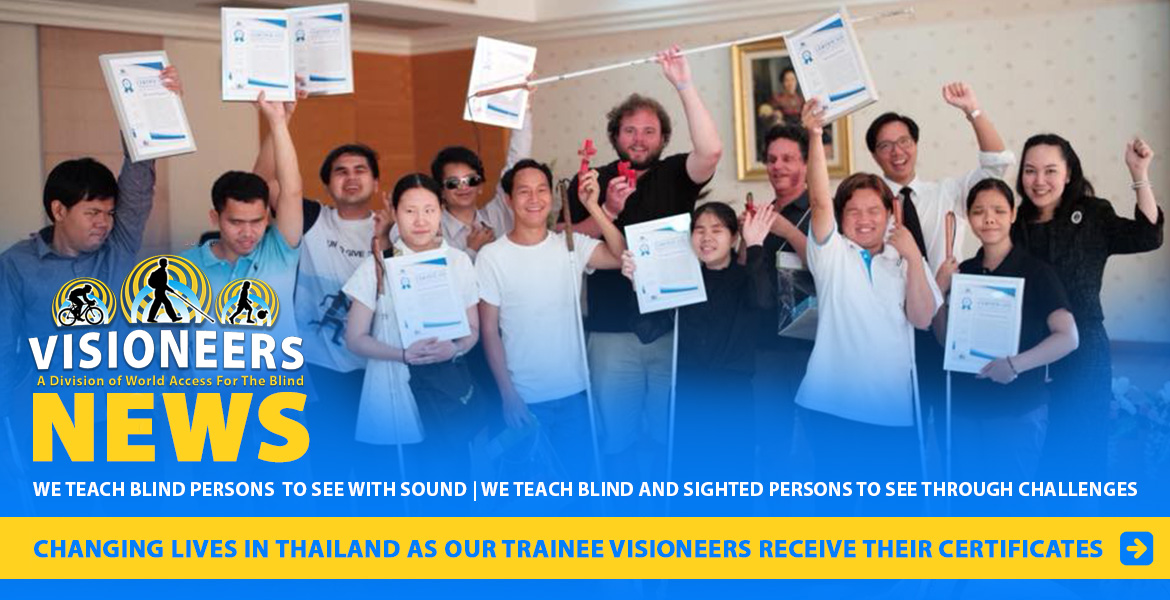 Visioneers News: Changing lives in Thailand as our trainee Visioneers receive their certificates. Image shows Visioneers Daniel Kish, Brian Bushway and Thomas Tajo standing with blind Visioneer trainees at the Foundation for the Blind in Thailand under the patronage of Her Majesty The Queen, and Good Intentions, a volunteer group. The trainees are showing off their framed certificates of achieving a certain Instructor level.