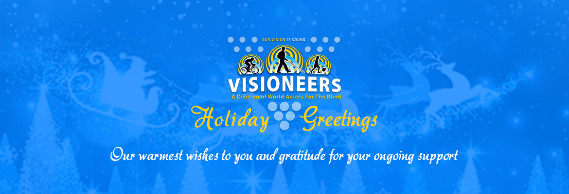 Visioneers Holiday Greetings, Our warmest wishes to you and gratitude for your ongoing support. Image: Visioneers logo is set against a transparent blue background with an illistration of Santa and his reindeer flying over treetops in falling snow.