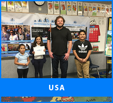 USA. Senior Visioneer Brian Bushway stands for a photo with students at a Los Angeles school after a FlashSonar Workshop at their Science Fair.