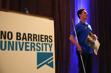 Image: Daniel Kish speaks onstage at No Barriers University.