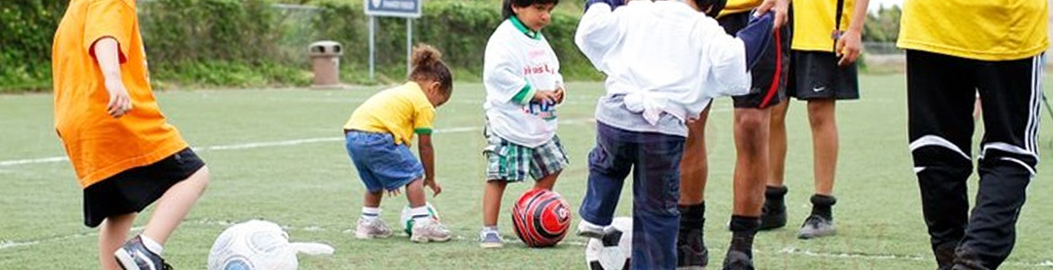 Young blind children play with soccer balls wrapped in plastic bags for auditory recognition at one of our recreational workshops.