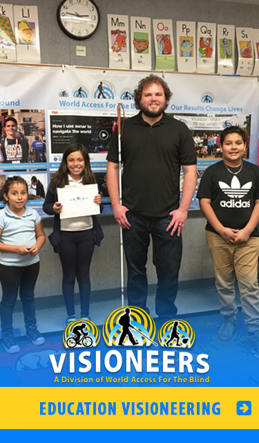 Category link: Education Visioneering. Senior Visioneer Brian Bushway is pictured with three students at a Los Angeles primary school.