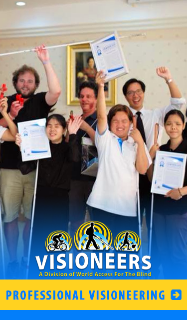 Professional Visioneering Category link. Image: Daniel Kish and Brian Bushway join Professor ML Taya Kitiyakara, President of the Echolocation Project for the Foundation for the Blind in Thailand under the patronage of Her Majesty the Queen, and Blind Student Instructors as they show off their Instructor Certifications.