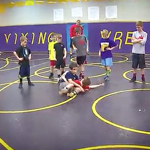 Image: Video still frame of Humoody wrestling in grade school.