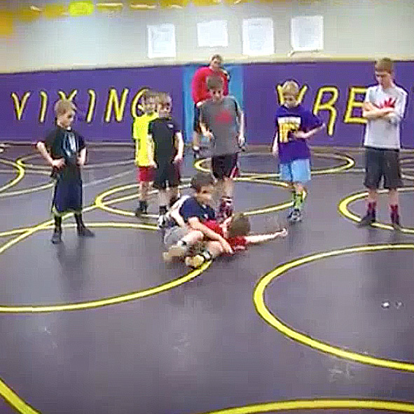 Image: Video still frame of Humoody wrestling in grade school.