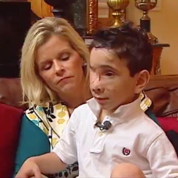 Image: Video still of Humoody Smith with his adoptive mother Julie Robinett Smith from KOMO TV in Seattle, Washington.
