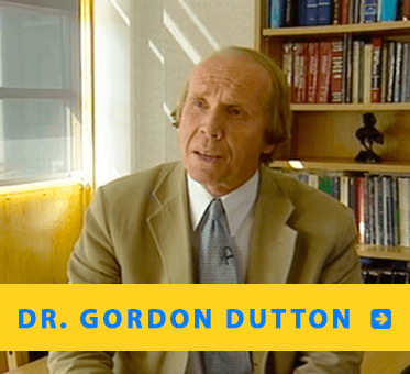 """Photo of Dr. Gordon Dutton sitting in front of a bookcase links to his review of """"Echolocation and FlashSonar."""