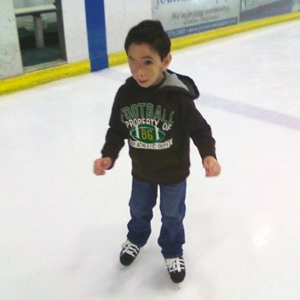 Photo of pint-sized Humoody Smith ice skating.
