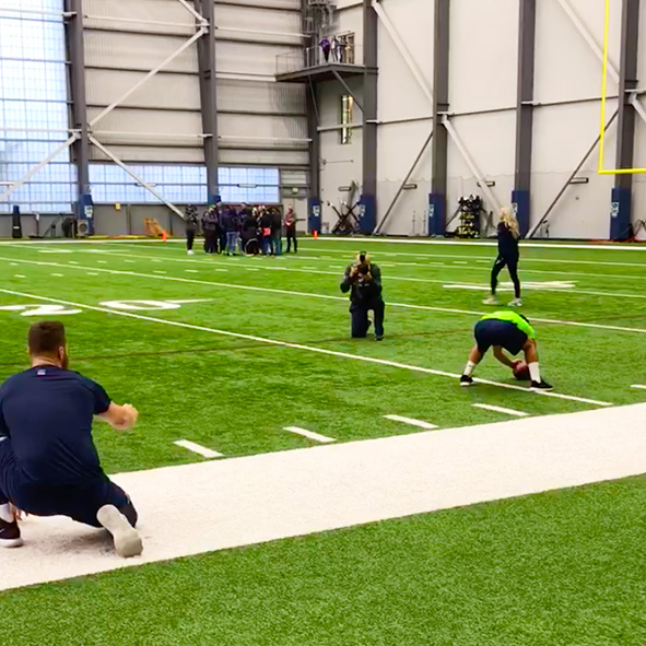 Photo: Student Visioneer Humoody Smith snaps the football to Seattle Seahawks Long Snapper Tyler Ott at the team's Virgina Mason Athletic Center.