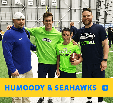 Photolink to Humoody page shows our Student Visioneer at a practice with some Seattle Seahawks NFL players.