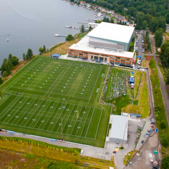 Aerial photo of the Seattle Seahawks Virginia Mason Athletic Center showing three outdoor football fields and the huge indoor facility.