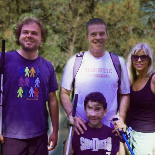 Senior Visioneer Brian Bushway stands with 9 year old Humoody Smith and his parents Randy and Julie Smith while hiking in the San Gabriel Mountains near Los Angeles in 2012.