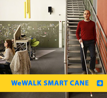 WeWALK Smart Cane. Image: WeWALK developer Kürşat Ceylan navigates down a set of stairs using his smart cane.