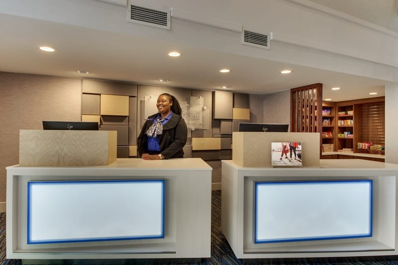 IHG Approved Photography for Holiday Inn Express Emory Front Desk W Staff 2