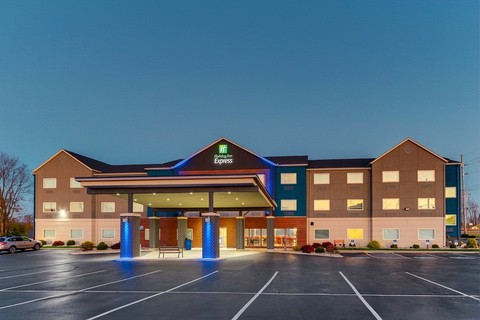 Hotel photography of Holiday Inn Express hotel exterior at twilight