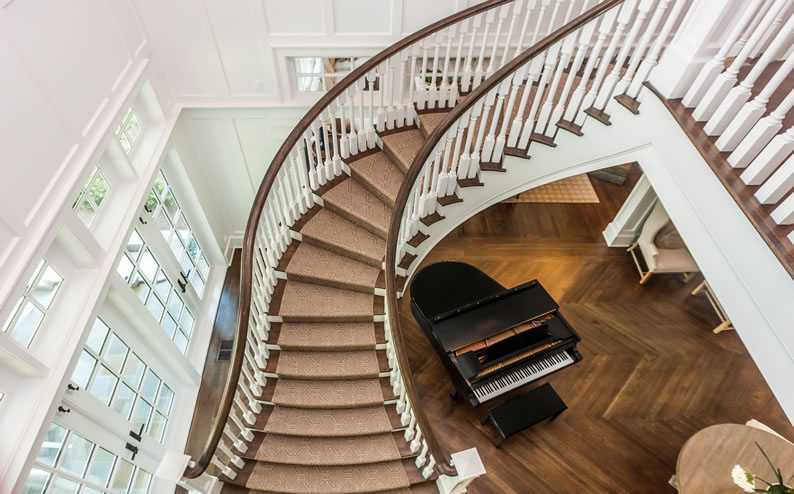 Curved Stair with Wood Baluster and Box Newels