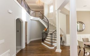Curved Staircase with custom Moulding and Millwork