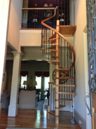 07 - Spiral stair with White Oak treads and metal balusters