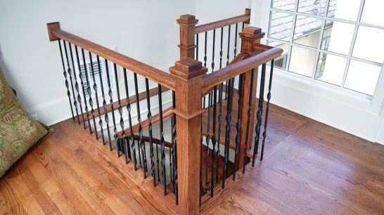 Red Oak Spiral stair landing with box newel post