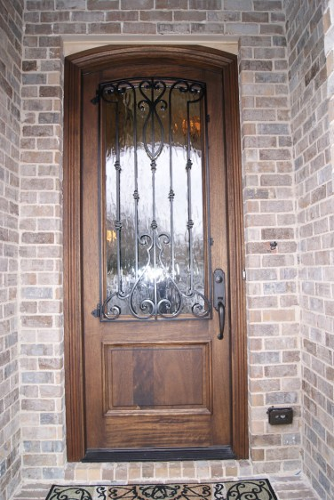 16 - Custom Mahogany Front Door with Iron and Glacier glass