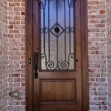 20 - Mahogany single door with Madelaine Iron
