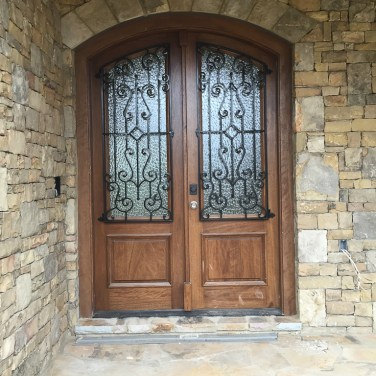 25 - Soft Arched double mahogany door with Iron grills