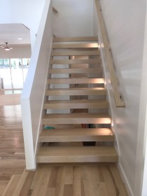 37 - Closed stringer open riser stair with block treads