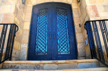 38 - Forged Iron door full lite glass