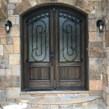41 - Soft Arch Mahogany Double Door with Hammered glass and Iron grill