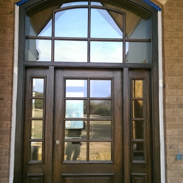 44 - Mahogany single door with side lites and custom transom and clear glass