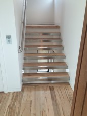 44 - Open riser Straight stair with Stainless Cap treads