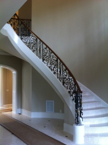 Modern Curve stair with closed stringers and marble treads