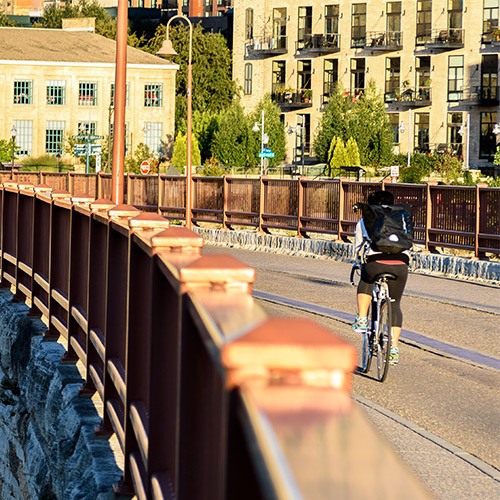 Biker on Stone Arch Bridge in Minneapolis